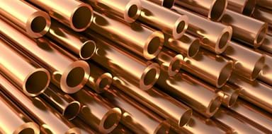 Close up of a stack of copper pipes