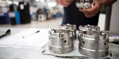 Engineer inspecting machined parts at Beverston Engineering